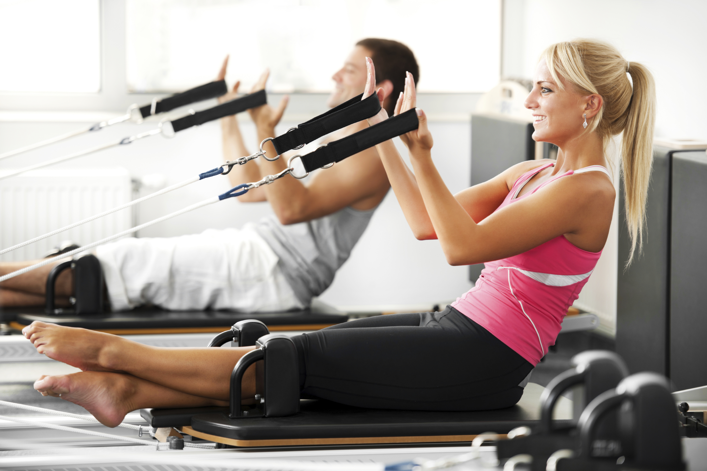 Two people doing Pilates exercises.   [url=http://www.istockphoto.com/search/lightbox/9786766][img]http://dl.dropbox.com/u/40117171/sport.jpg[/img][/url]