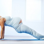 Young pregnant woman doing relaxation exercise.  [url=http://www.istockphoto.com/search/lightbox/9786766][img]http://dl.dropbox.com/u/40117171/sport.jpg[/img][/url]