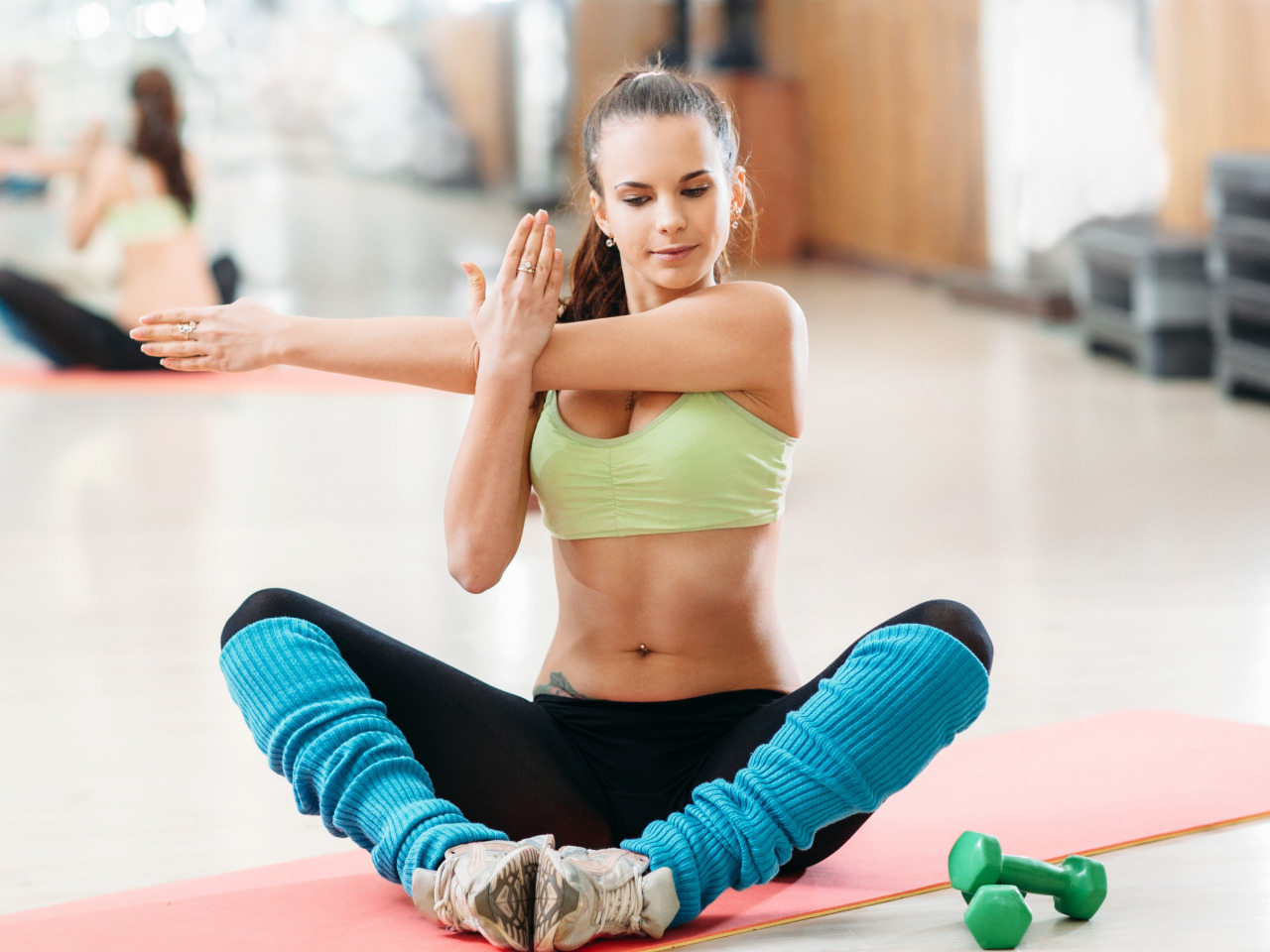 workout-stretching-arms-back-floor-fitness